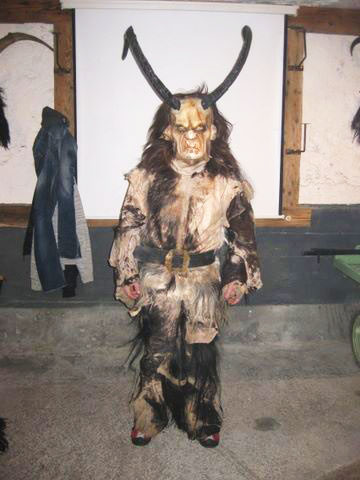 Animal hide suit — $370. Carved wooden mask with plastic horns — $580