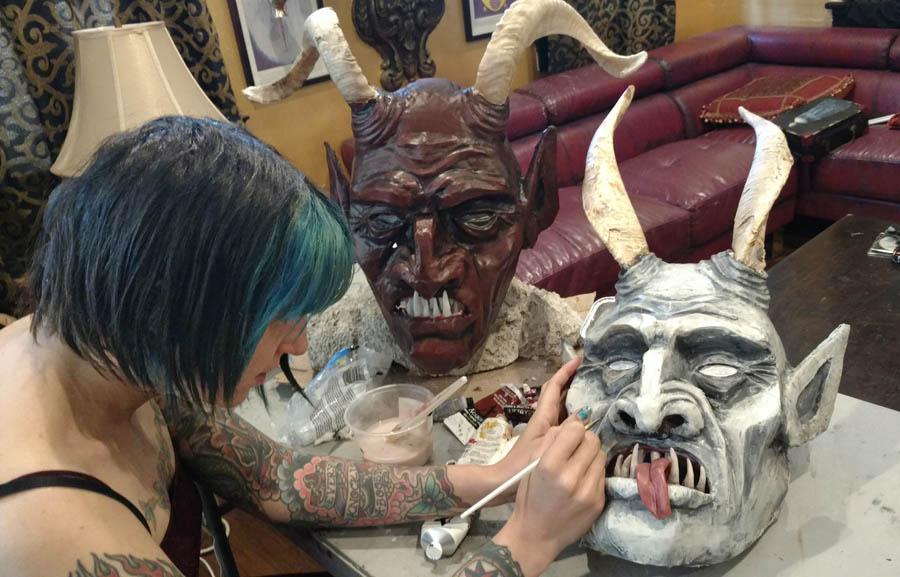 instructor Lauren Church works on masks used in workshop.